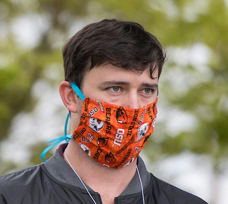 TRACE field staff member wearing mask.