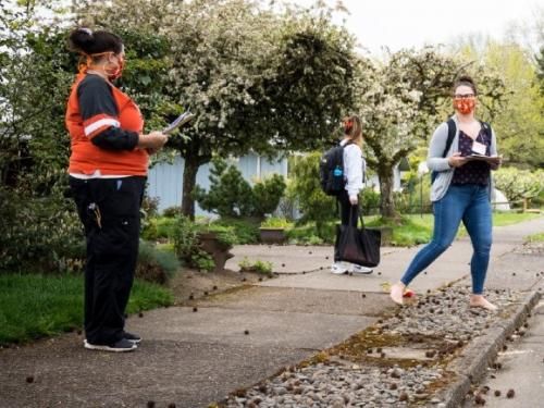 TRACE volunteers work through selected neighborhoods