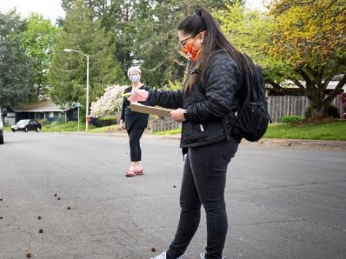 TRACE volunteers take notes in a Corvallis neighborhood