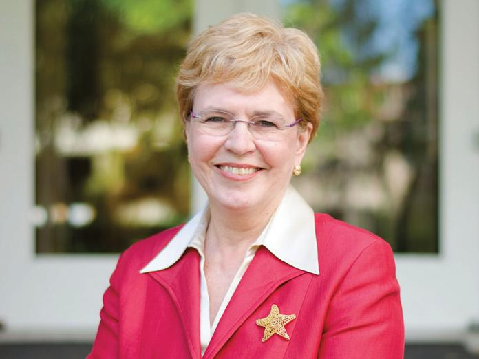 Jane Lubchenco standing on porch